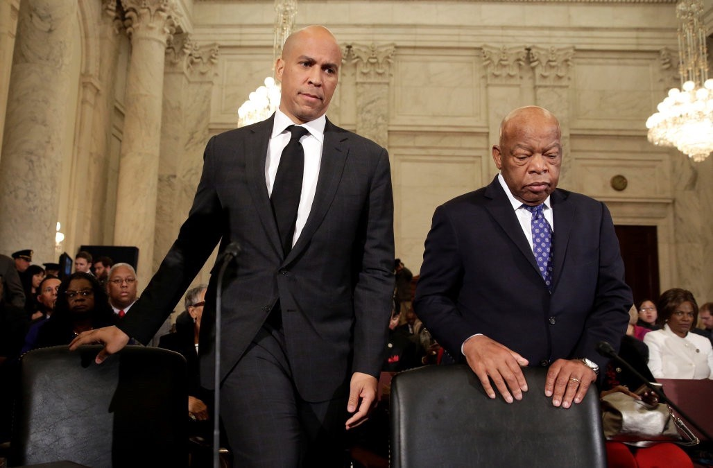 Senator Cory Booker and John Lewis take their seats before testifying against Jeff Session's confirmation (<a href=