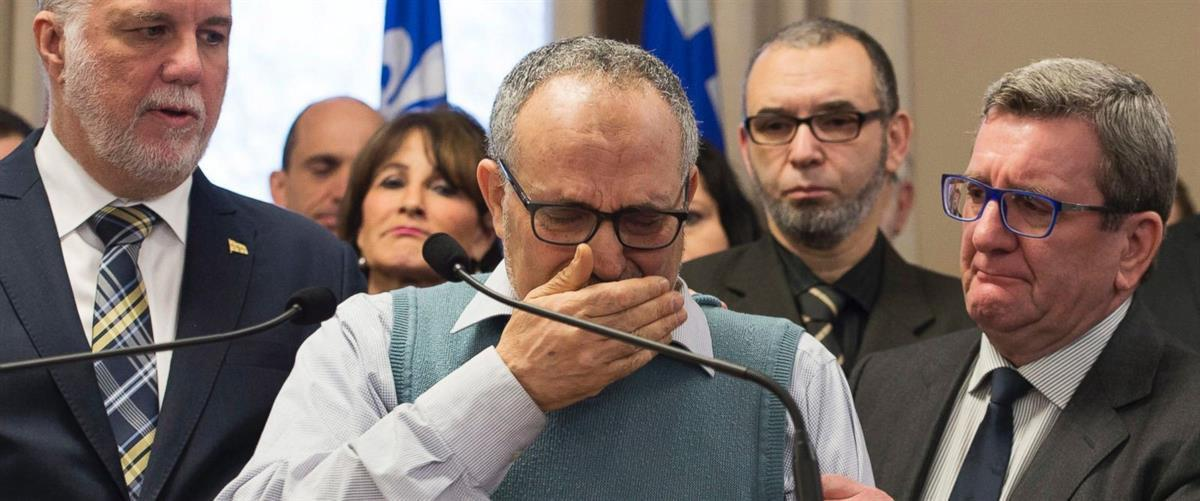 Centre culturel islamique de Québec vice-president Mohamed Labidi cries at a press conference with Quebec Premier Philippe Couillard, left, and Quebec City mayor Regis Labeaume, right (Jacques Boissinot / The CanadianPress).