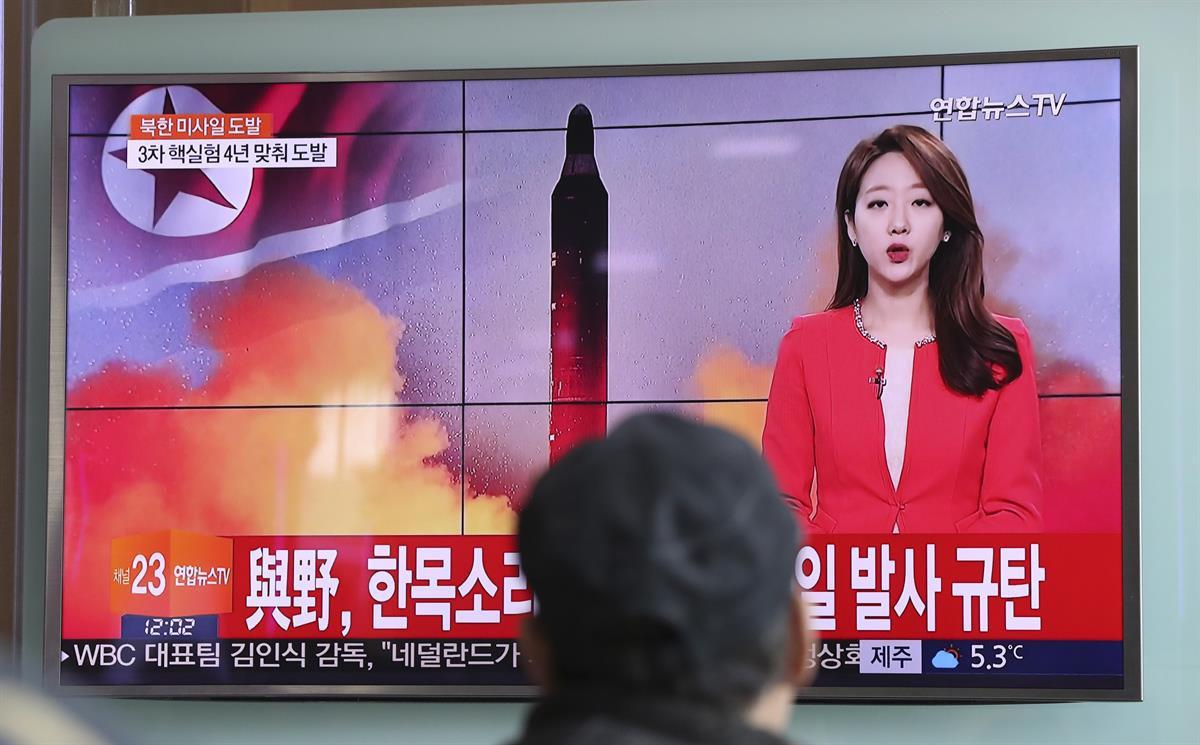 A man watches a TV news program reporting about North Korea's missile launch with a file image of a North Korean missile at the Seoul Train Station in Seoul, South Korea. Sunday, Feb. 12, 2017. (AP Photo/Lee Jin-man)