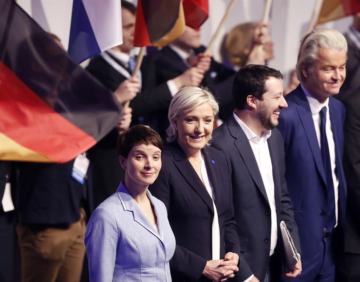 AfD (Alternative for Germany) chairwoman Frauke Petry, Far-right leader and candidate for next spring presidential elections Marine le Pen from France, Italian Lega Nord chief Matteo Salvini and Dutch populist anti-Islam lawmaker Geert Wilders, from left, stand together in the beginning of a meeting of European Nationalists in Koblenz, Germany, Saturday, Jan. 21, 2017. (AP Photo/Michael Probst)