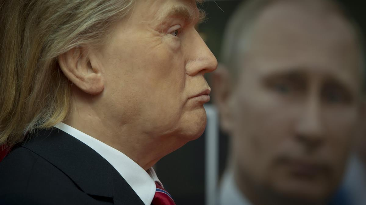 Wax model of President Donald Trump stands near a portrait of Russian President Vladimir Putin, displayed in the wax museum in Sofia, Bulgaria—Friday March 31, 2017 (AP Photo/Valentina Petrova)