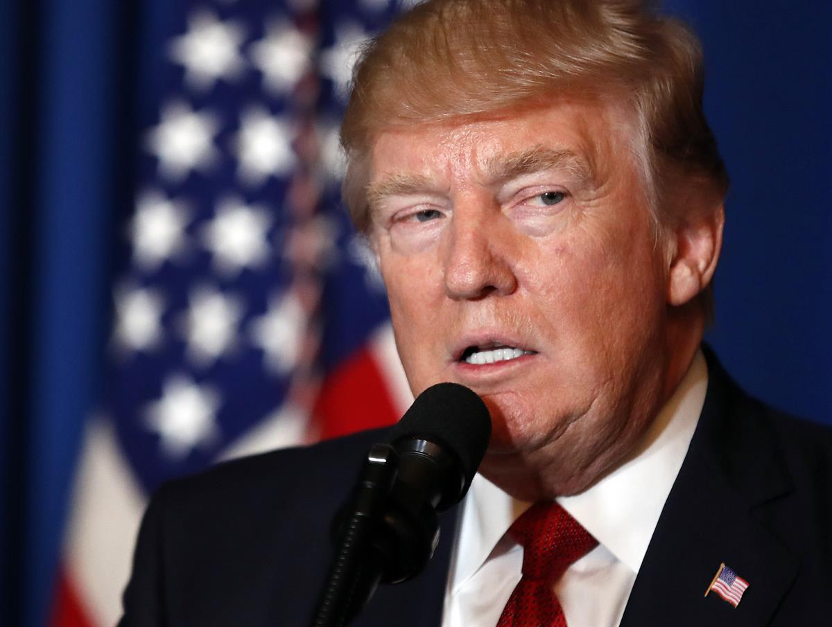 President Donald Trump speaks at Mar-a-Lago in Palm Beach, Fla., Thursday, April 6, 2017, after the U.S. fired a barrage of cruise missiles into Syria Thursday night. (AP Photo/Alex Brandon)