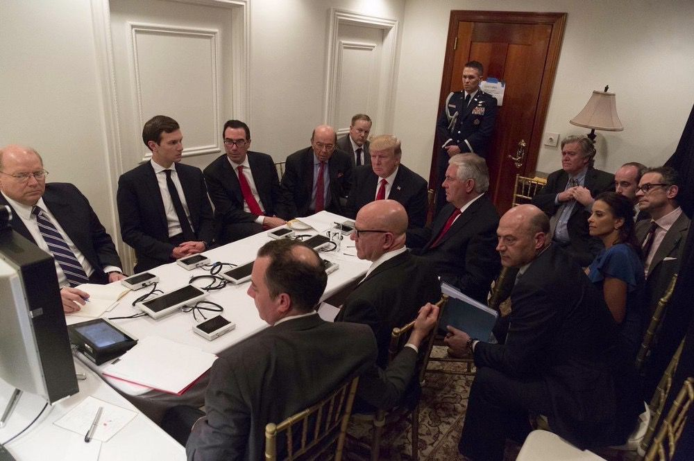President Donald Trump receives a briefing on the Syria military strike from his National Security team after the strike at Mar-a-Lago in Palm Beach, Fla., Thursday night, April 6, 2017. (White House viaAP)