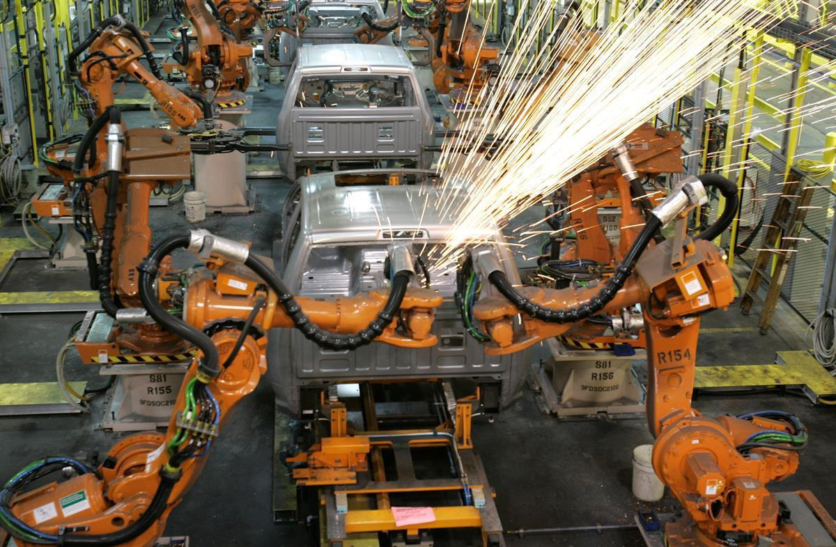 Assembly line robots weld the front cab of Chrysler's 2009 Dodge Ram pickup in Warren, Michigan — Dec. 17, 2008 (AP Photo/Carlos Osorio, file)