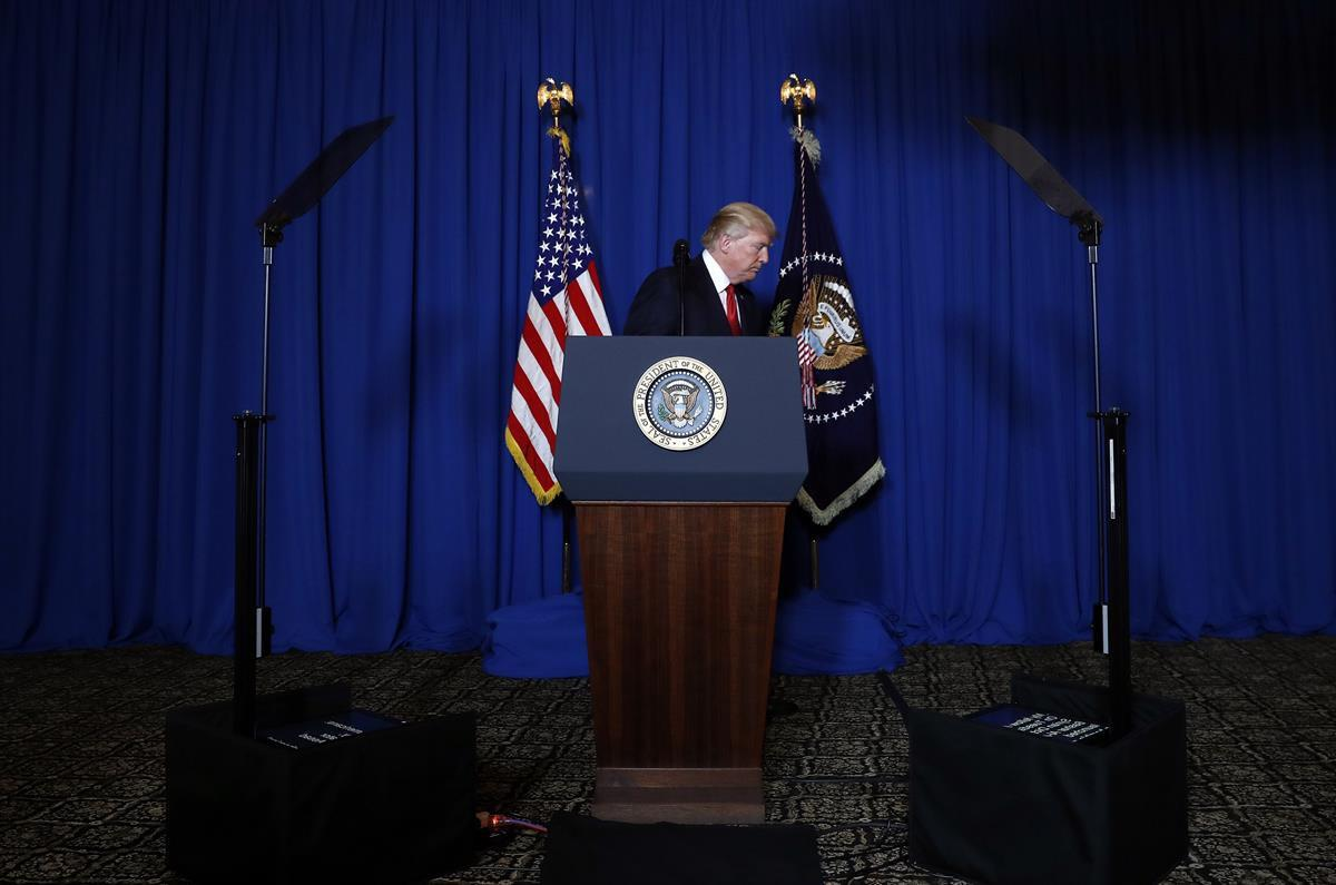 President Donald Trump walks away from the podium after speaking on the Syria strike—Mar-a-Lago in Palm Beach, Fla. Thursday, April 6, 2017.(AP)