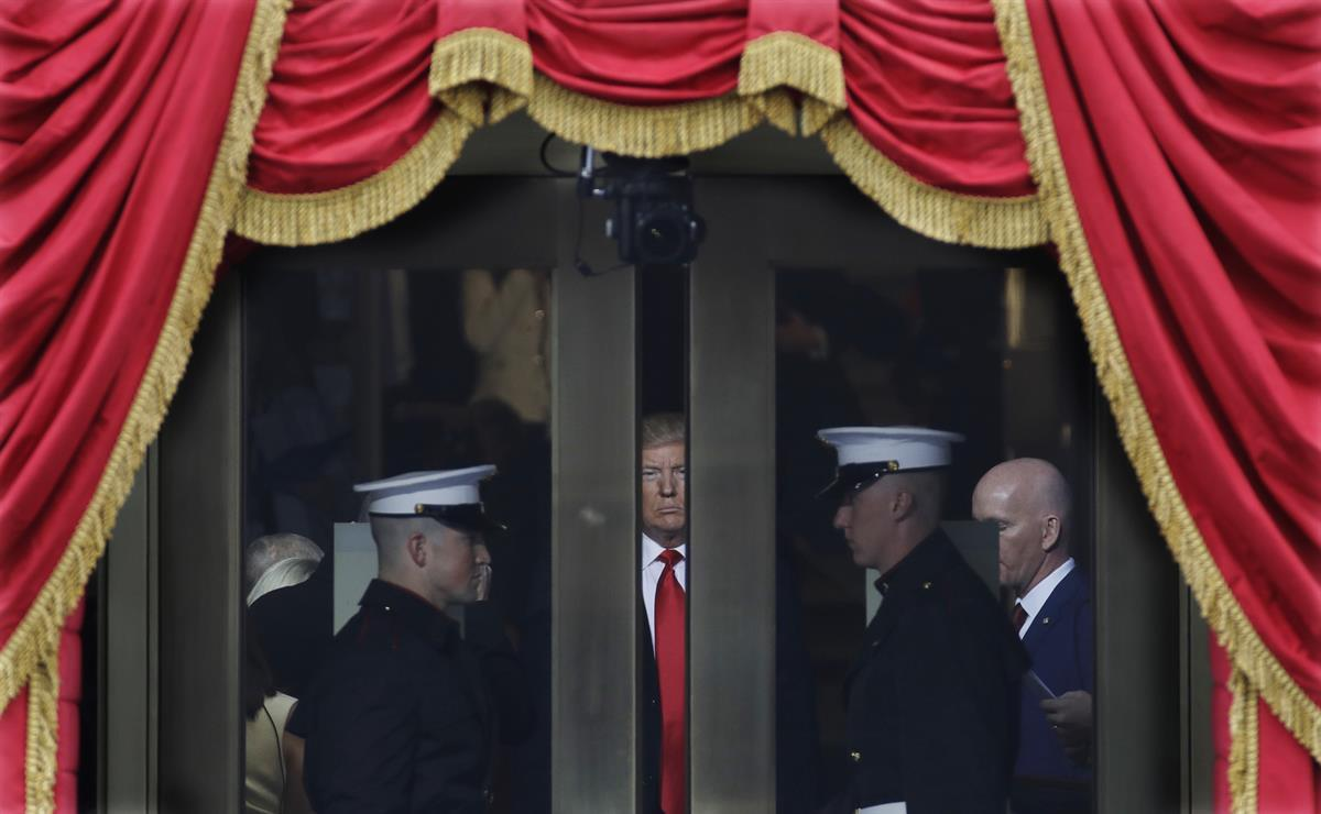 President Donald Trump waits to step out onto the portico for his Presidential Inauguration at the U.S. Capitol in Washington. Friday, Jan. 20, 2017. (AP Photo/Patrick Semansky)