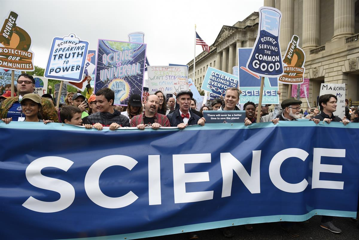 Protestors (including Bill Nye) carry a banner and signs as they pass the U.S. Environmental Protection Agency during the March For Science in Washington — Saturday, April 22, 2017 (AP Photo/Sait Serkan Gurbuz)
