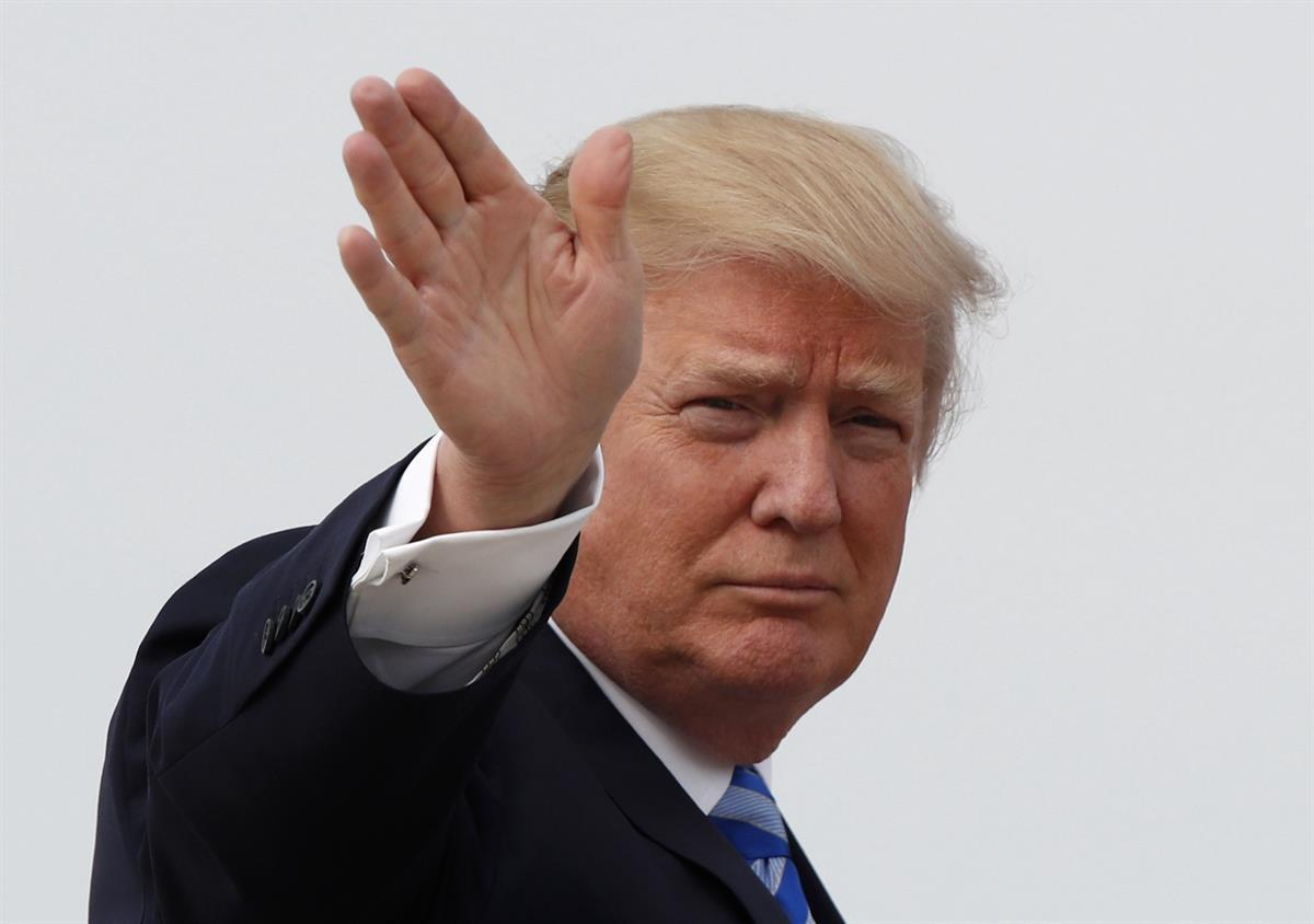 President Donald Trump waves as he boards Air Force One before his departure from Andrews Air Force Base, Md., Thursday, April 13, 2017, to his Mar-a-Largo resort in Florida. (AP Photo/Alex Brandon)