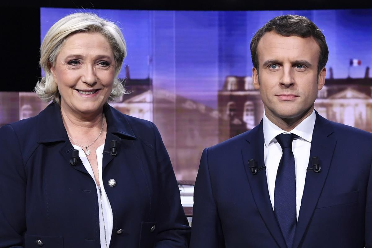 French presidential election candidate for the far-right Front National party, Marine Le Pen, left, and French presidential election candidate for the En Marche ! movement, Emmanuel Macron (Eric Feferberg/Pool Photo via AP)
