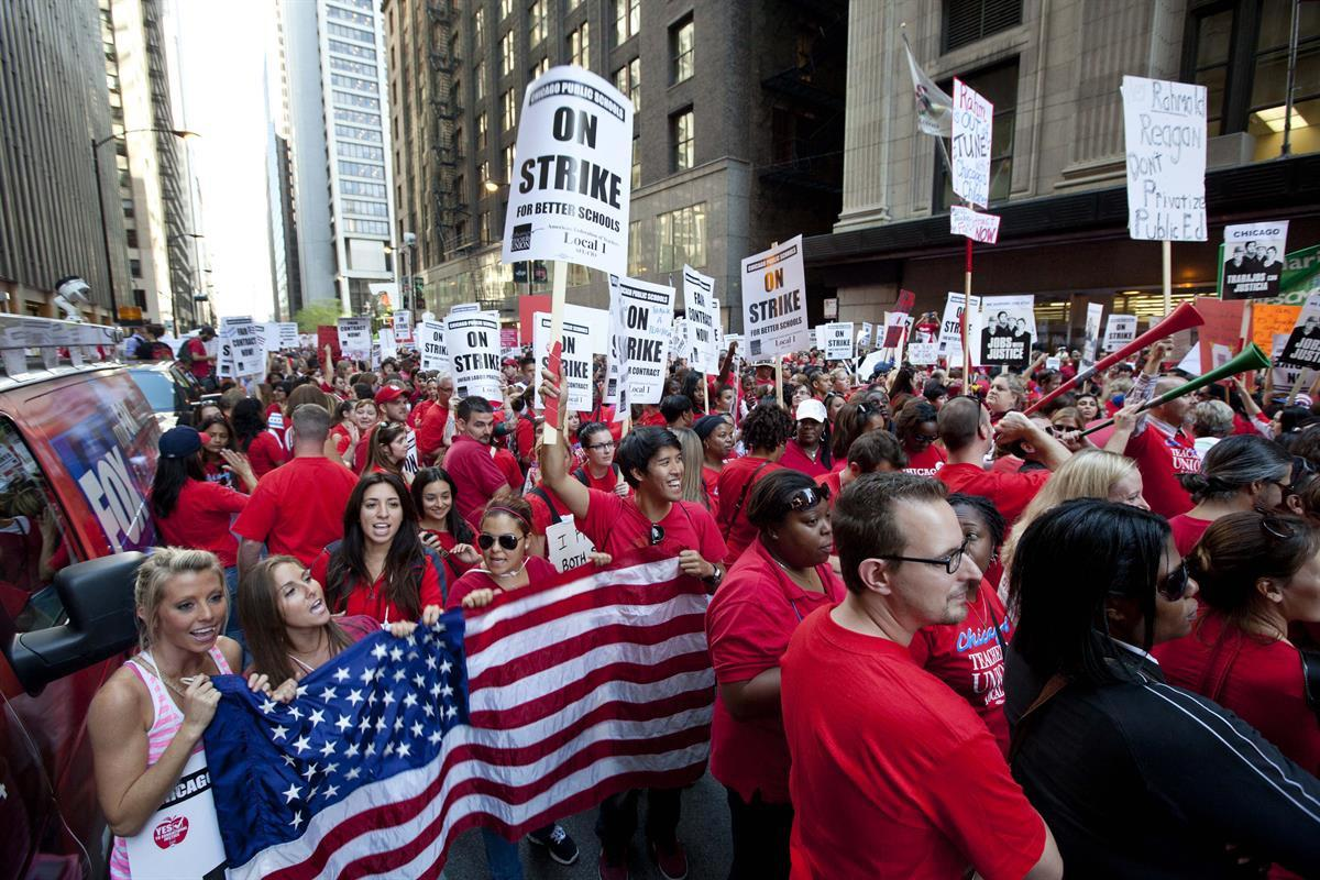 Thousands of public school teachers on strike in Chicago—September 2012 (AP Photo/Sitthixay Ditthavong, File)