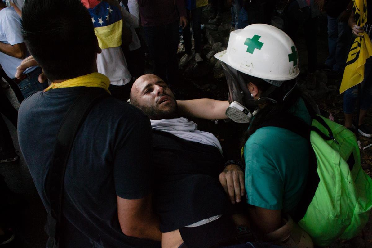 An injured protester being treated by volunteers (Photo by: <a href=
