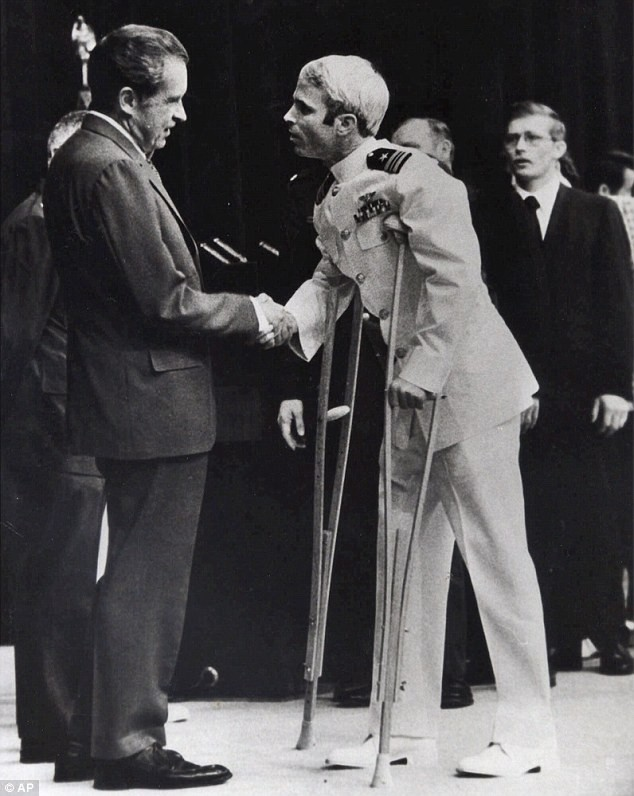 Photo Credit: AP Photo, John McCain shakes President Richard Nixon's hand after his release in 1973, following five years as a prisoner in Vietnam.