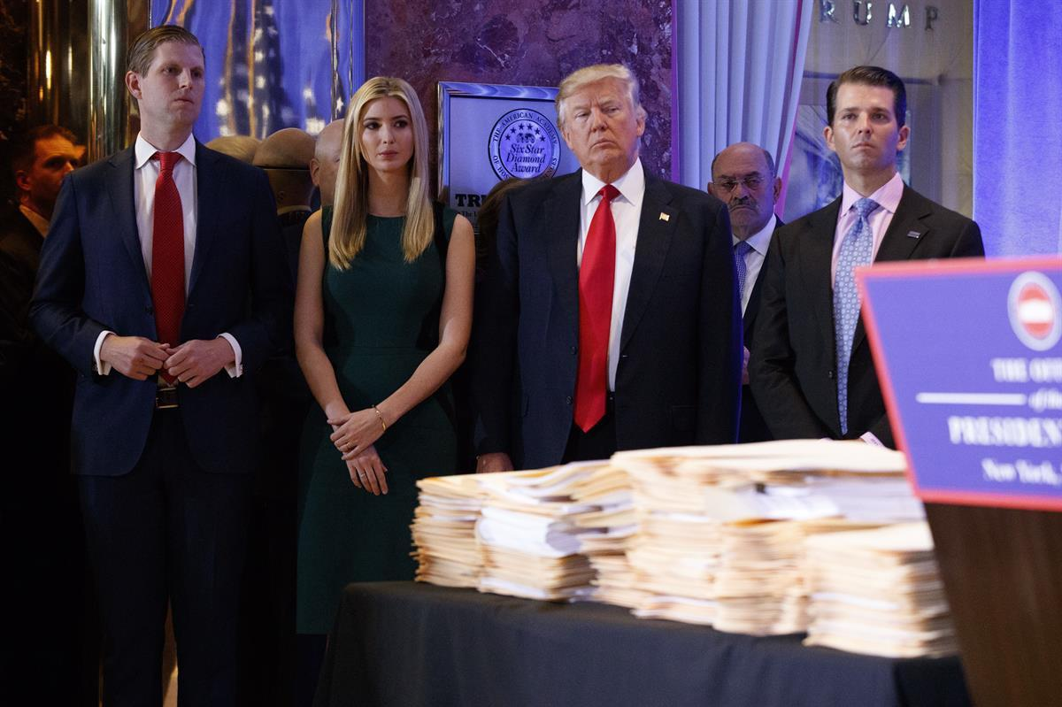 President-elect Donald Trump, accompanied by his family, at news conference in the lobby of Trump Tower in New York Wednesday Jan. 11, 2017. (AP Photo/Evan Vucci)