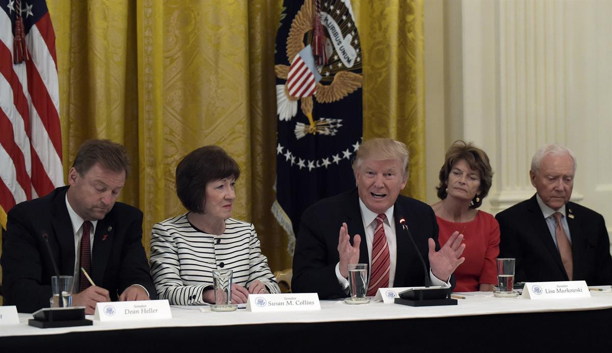 The day McConnell delayed the health care vote, President Donald Trump met with Republican senators in the White House. Seated with him, from left, are Dean Heller (R-NV), Susan Collins (R-ME), Lisa Murkowski (R-AK), and Sen. Orrin Hatch, R-Utah — Tuesday, June 27, 2017 (AP/Susan Walsh)
