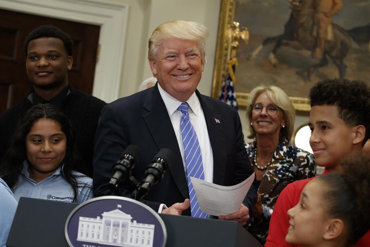 President Donald Trump, accompanied by Education Secretary Betsy DeVos, arrives to speak during a school choice event in the Roosevelt Room of the White House — May 3, 2017. (AP/Evan Vucci)