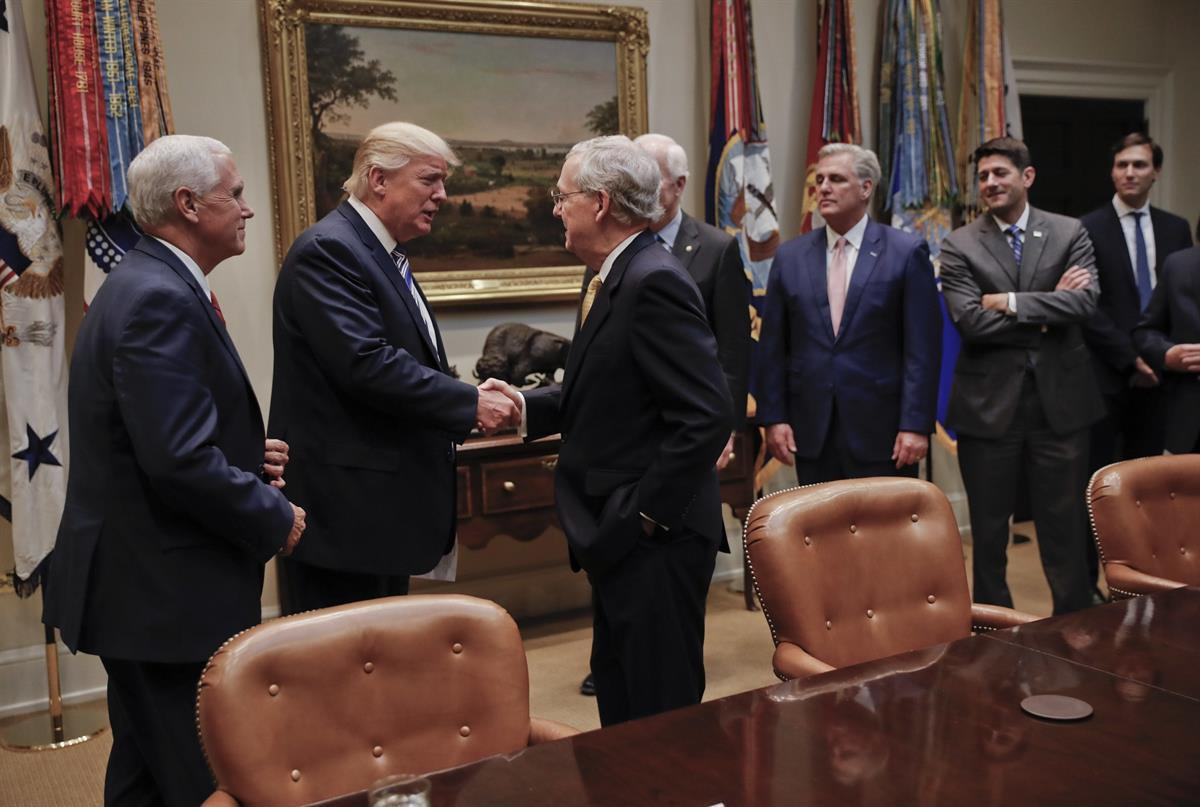 President Donald Trump shakes hands with Senate Majority Leader Mitch McConnell (R-KY), center. Also in the room are from left, Vice President Mike Pence, SenateMajority Whip John Cornyn (R-TX), House Majority Leader Kevin McCarthy (R-CA), House Speaker Paul Ryan (R-WI)., and Senior adviser to President Donald Trump Jared Kushner — June 6, 2017 (AP)