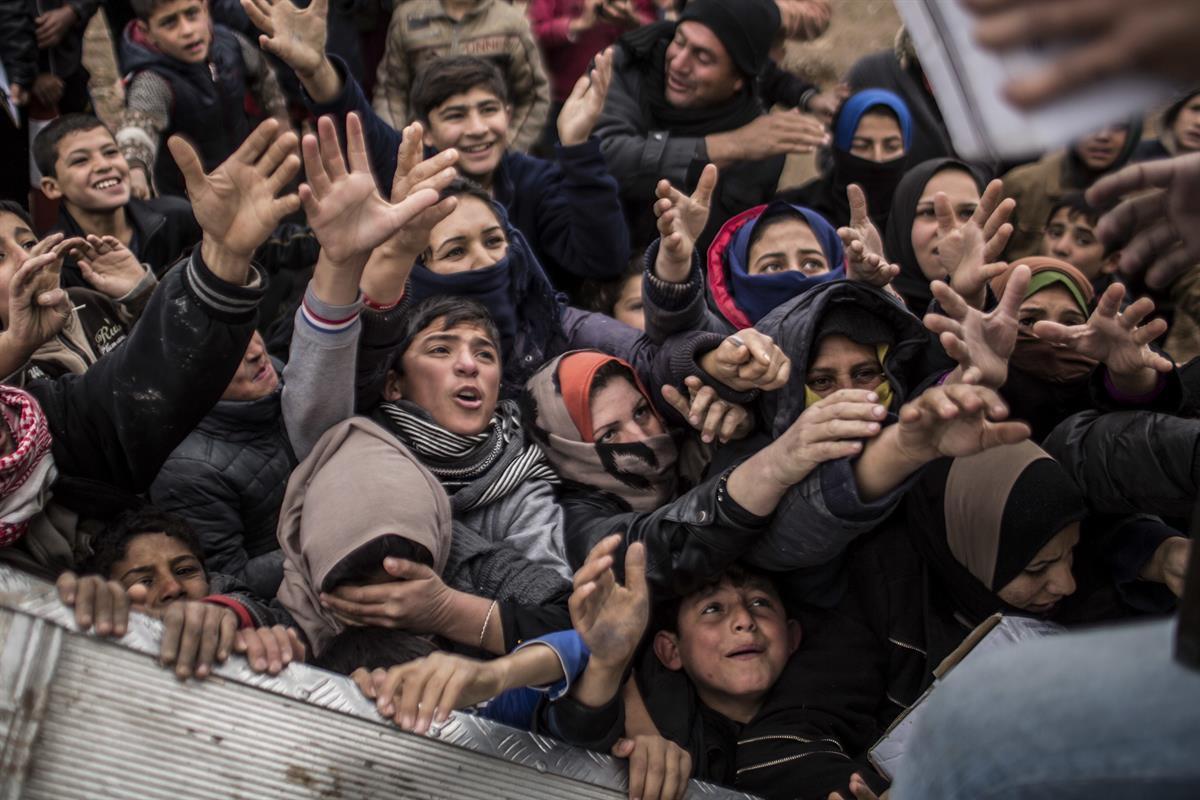 Iraqi displaced people plead for food during an aid distribution in Khazer camp for the displaced in Iraqi Kurdistan, Iraq—Dec. 17, 2016 (AP/ManuBrabo)