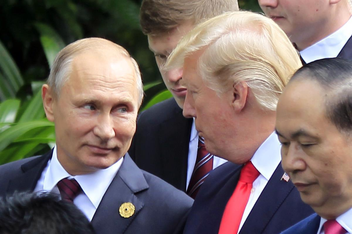 Russian President Vladimir Putin, left, and U.S. President Donald Trump talk as they arrive for the family photo session during the Asia-Pacific Economic Cooperation (APEC) Summit in Danang, Vietnam, Saturday, Nov. 11, 2017. (AP Photo/Hau Dinh)