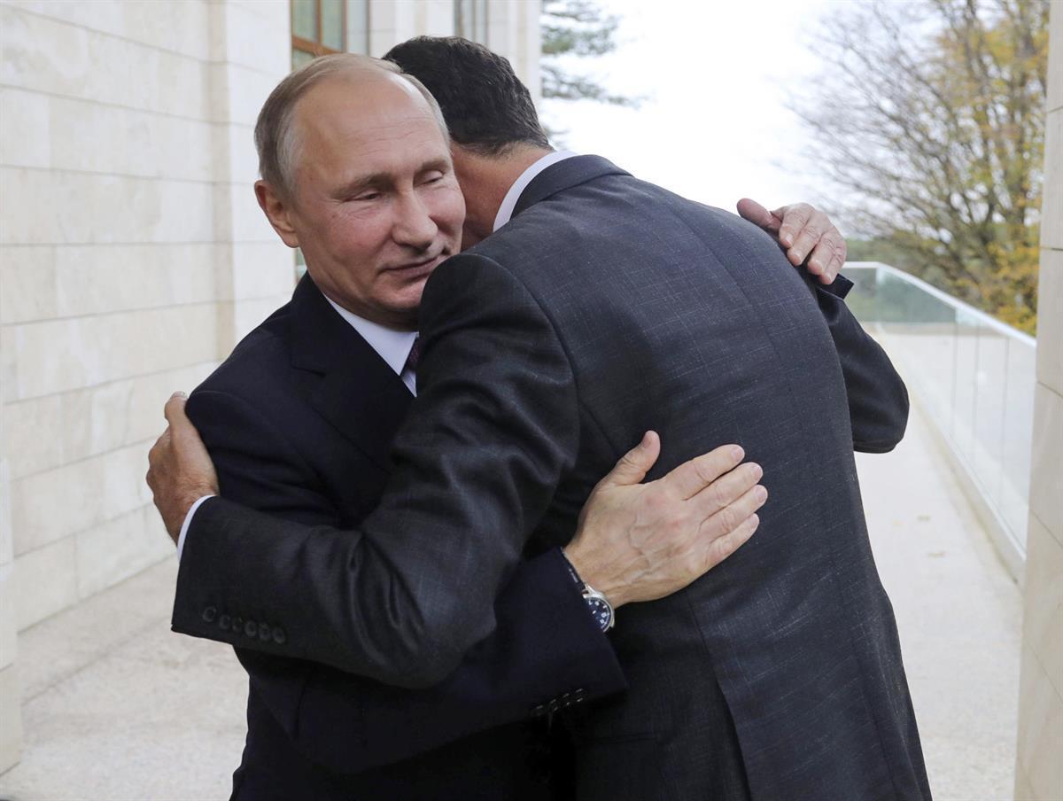 Russian President Vladimir Putin, left, embraces Syrian President Bashar Assad in the Bocharov Ruchei residence in the Black Sea resort of Sochi, Russia—Nov. 20, 2017 (Mikhail Klimentyev, Kremlin Pool Photo viaAP)