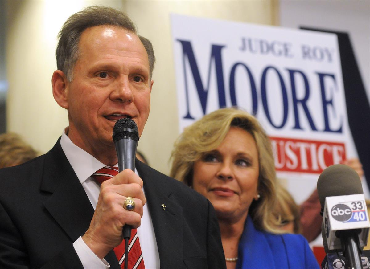Roy Moore speaks to the audience as wife Kayla looks on at his election party in Montgomery, Ala., on election night—Nov. 6, 2012 (AP Photo/David Bundy,File)