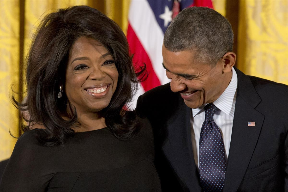 President Barack Obama laughs with Oprah Winfrey in the East Room of the White House in Washington, Wednesday, Nov. 20, 2013, before awarding her the Presidential Medal of Freedom. (AP Photo/Jacquelyn Martin)