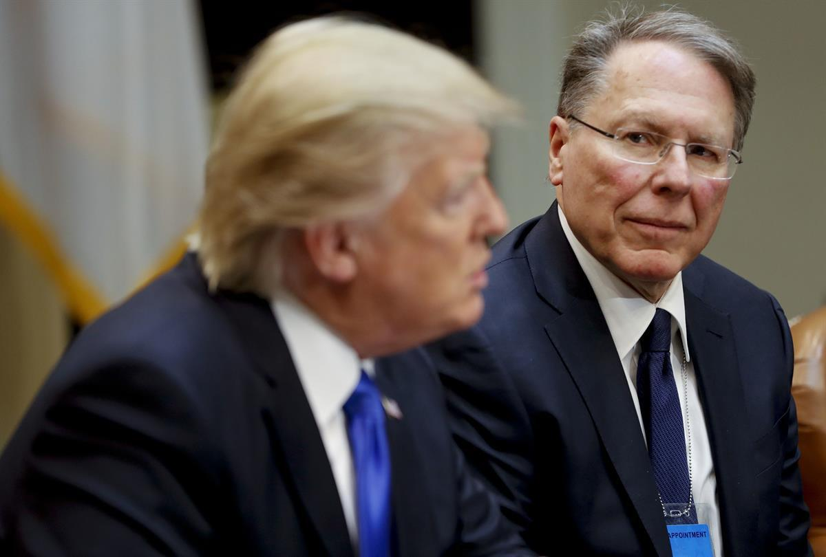 National Rifle Associations (NRA) Executive Vice President and Chief Executive Officer Wayne LaPierre listens at right as President Donald Trump speaks in the Roosevelt Room of the White House in Washington — Feb. 1, 2017 (AP Photo/Pablo Martinez Monsivais)